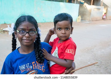 PONDICHERY, PUDUCHERRY, TAMIL NADU, INDIA - SEPTEMBER Circa, 2017. An unidentified poor girl in a small village, outdoor, looking at the camera