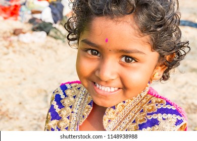 PONDICHERY, PUDUCHERRY, TAMIL NADU, INDIA - MARCH CIRCA, 2018. Unidentified Smiling face portrait of a young child or young girl from rural part of India
