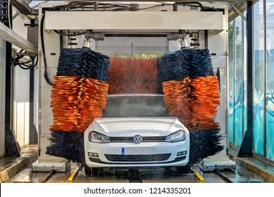 Ponferrada, Spain. Circa October 2018. Volkswagen Golf in automatic car wash.