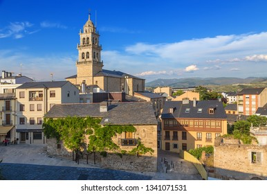 PONFERRADA, SPAIN - JUN 12, 2017: Scenic view of the city and the Basilica of Encina at sunset