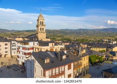 PONFERRADA, SPAIN - JUN 12, 2017: View of the city and the Basilica of Encina at sunset