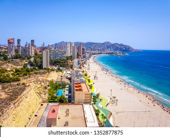 Poniente beach of Benidorm in summer seen from the heights of a skyscraper with the beach, the sea and other buildings of hotels and apartments.