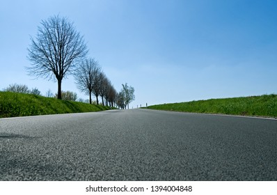 Ponitz / Germany: Newly asphalted country road in Eastern Thuringia on a sunny day in April