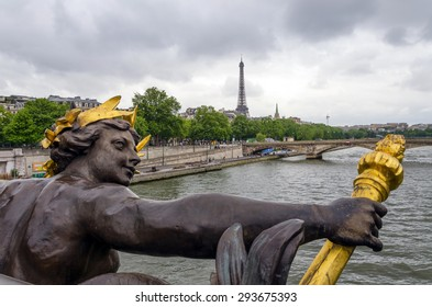 Pont Alexandre III across the River Seine with Eiffel Tower in Paris, France