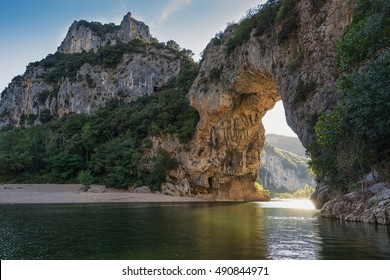 The Pont d'Arc is a large natural bridge, located in the Ardeche departement in the south of Franc. The arch, carved out by the Ardeche River, is 60 m wide and 54 m high.