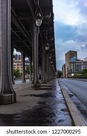 Pont de bir hakeim metro bridge paris france during summer with thick cloud covered sky