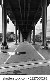 Pont de bir hakeim metro bridge in black and white paris france paris france during summer with thick cloud covered sky