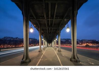 Pont de Bir-hakeim, inception bridge with car light tail during twilight, Paris, France