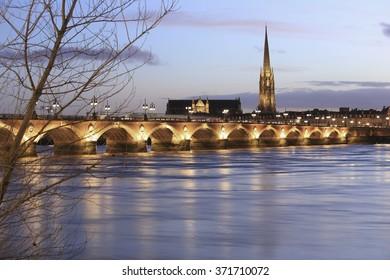 Pont de Pierre bridge with St Michel cathedral, Bordeaux, France