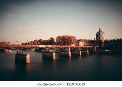 Pont des Arts and Institut de France in Paris, France.