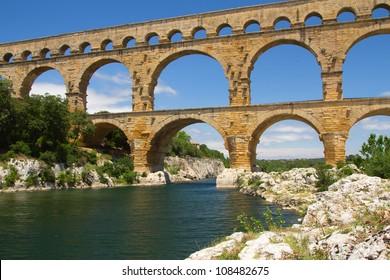 The Pont du Gard is an ancient Roman aqueduct bridge that crosses the Gardon River in southern France