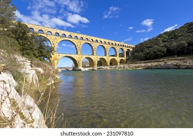 Pont Du Gard Bridge, La Provence, France. The bridge is an two thousand years old roman aqueduct that crosses the Gardon River. Built by the Romans to carry water from a spring to the town Nimes.