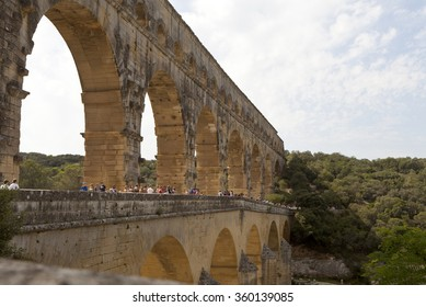 Pont du Gard, France - August 18th, 2014: Pont du Gard is an ancient roman aqueduct that crosses the Gardon river in the south of France.