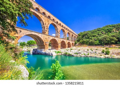Pont du Gard three-tiered aqueduct was built in Roman times on the river Gardon. Provence summer day.