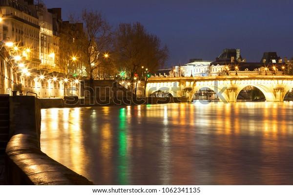 The Pont Neuf New Bridge , the oldest standing bridge across the river Seine in Paris, France.