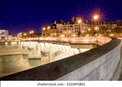 The pont Neuf is the oldest standing bridge across the river Seine in Paris.The bridge is composed of two separate spans, one of five arches joining to the left bank to the Ile de la Cite .
