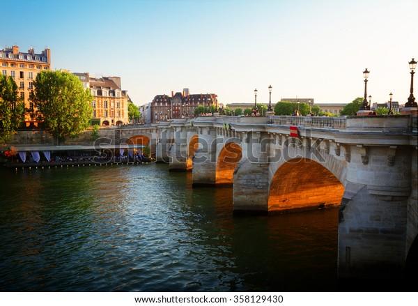 Pont Neuf at sunny summer sunset, Paris, France, toned