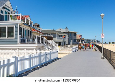 Pont Pleasant Beach, New Jersey / USA - 07 19 2018: waterfront street with hotels and vacation homes on ocean beach, popular touristic place.