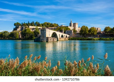 Pont Saint Benezet bridge, Palace of the Popes or Palais des Papes and Avignon Cathedral aerial panoramic view in Avignon city in France