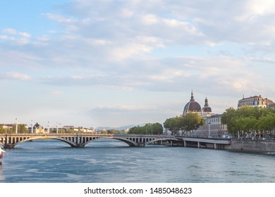 Pont Wilson bridge in Lyon, France over a panorama of the riverbank of the Rhone river (Quais de Rhone) with the main monuments of the old Lyon in background