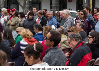 Ponta Delgada, Azores/Portugal - April 25, 2019: People celebrating Portugal national holiday, 25 of April, Carnation Revolution day on the main square in Ponta Delgada, on Sao Miguel island.