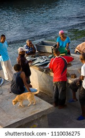 PONTA DO SOL, CAPE VERDE - DECEMBER 08, 2015: Villagers buying  freshly caught fish from fisherman right in the port