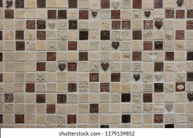 Ponta do Sol, Portugal - March 3, 2018: Square mosaics with hearts and romantic themes in Ponta do Sol