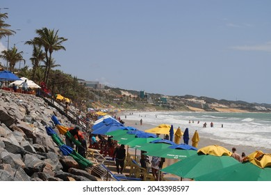 Ponta Negra Beach, Natal, Rio Grande do Norte, Brazil. - September 7th 2021: The most famous beach in the city of NatalBrazil. In a sunny day, people walking at the beach. Umbrellas are visible.