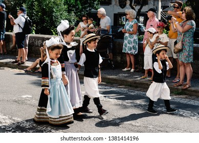 Pont-Aven, France - August 5, 2018: Festival of Gorse Flowers, a traditional parade with Celtic circles and bagadou, dance performances and music from Brittany
