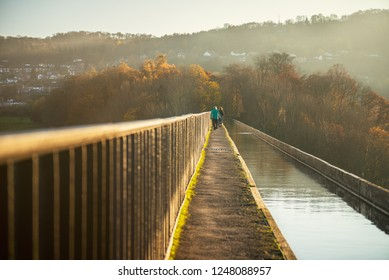 Pontcysyllte Aqueduct is a navigable aqueduct that carries the Llangollen Canal across the River Dee in the Vale of Llangollen in north east Wales, UK. Autumn Scenery