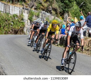 Pont-de-Montvert-Sud-Mont-Lozere, France - July 21, 2018: Thomas in Yellow Jersey and Froome in front of the peloton descending a road in Occitan region during the stage 14 of Tour de France 2018