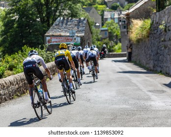 Pont-de-Montvert-Sud-Mont-Lozere, France - July 21, 2018: Rear view of the Team Sky,in front of the peloton, descending a road in Occitan region during the stage 14 of Tour de France 2018.
