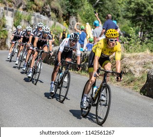 Pont-de-Montvert-Sud-Mont-Lozere, France - July 21, 2018: Egan Arley Bernal riding behind Geraint Thomas in Yellow Jersey on a descending road in Occitan region during the Tour de France 2018