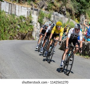 Pont-de-Montvert-Sud-Mont-Lozere, France - July 21, 2018: Chris Froome and Geraint Thomas in Yellow Jersey descending a road in Occitan region during the stage 14 of Tour de France 2018.