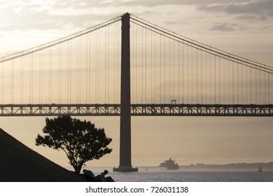 ponte 25 de abril bridge lisbon portugal with tree