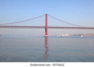 Ponte 25 de Abril - Suspension bridge over the Tagus river in Lisbon, Portugal