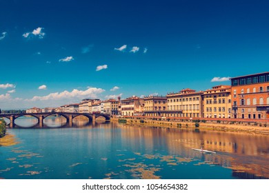 Ponte alla Carraia bridge over Arno river in Florence, Italy, at summer, toned image