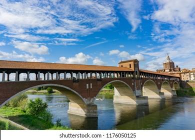 Ponte coperto ( covered bridge ) or Ponte Vecchio over Ticino river in Pavia, Lombardy, Italy