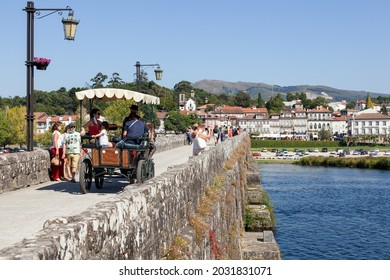 Ponte de Lima, Portugal, 19 august 2021: view over the city of Ponte de Lima and its main square from the Roman bridge. Highlight for a horse-drawn carriage for tourists