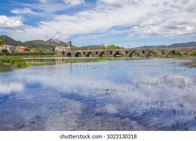 PONTE DE LIMA, PORTUGAL - APRIL 24, 2016: Church and roman bridge in Ponte de Lima, Portugal