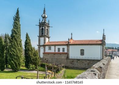 PONTE DE LIMA, PORTUGAL - CIRCA APRIL 2018: Santo Antonio da Torre Velha church with roman bridge in Ponte de Lima town, Portugal.