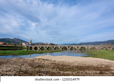 Ponte de Lima, Portugal; December 2015: Church and roman bridge in Ponte de Lima, Oldest city in Portugal. It is named for a long medieval bridge that runs across the Lima River.