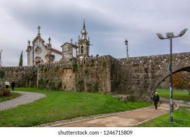Ponte de Lima, Portugal ; December 2015: Baroque church of Santo Antonio and Roman Bridge of the village of Ponte de Lima