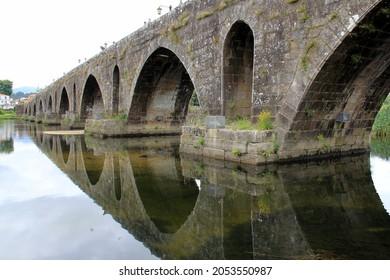 Ponte de Lima, Portugal - July 20, 2021: Medieval stone bridge over the Lima River