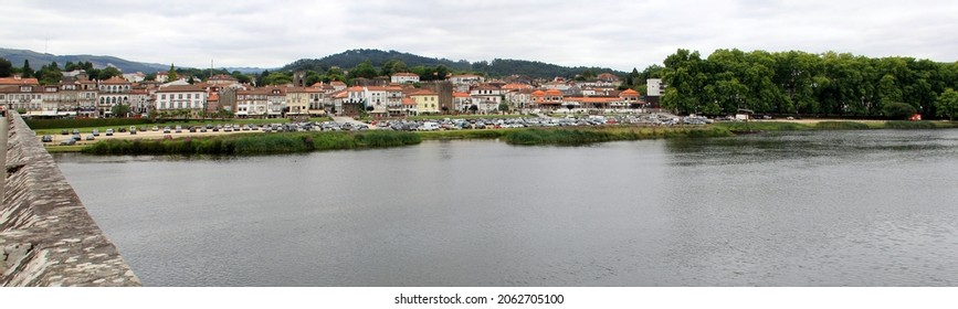 Ponte de Lima, Portugal - July 20, 2021: Panoramic view of the left bank of the Lima River, south of the medieval bridge