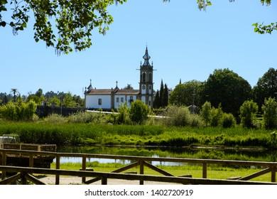Ponte de Lima , Portugal - May 13, 2019: On the banks of the Lima River, the Church of Santo Antonio da Torre Velha, Ponte de Lima , Portugal.