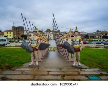 PONTE DE LIMA, PORTUGAL - Oct 28, 2019: Statues of Roman soldiers near Lima River at Ponte de Lima.
