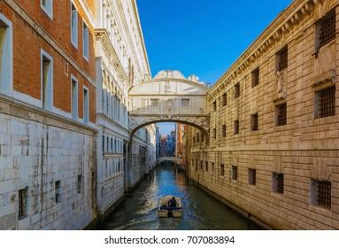 Ponte dei Sospiri bridge crossing canal, famous travel destination of Venice near St. Mark's Square in Italy