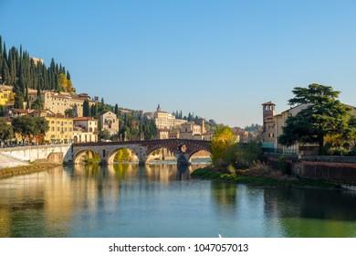 Ponte Pietra bridge on Adige river sunny day in  Verona, Italy.