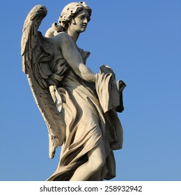 Ponte Sant' Angelo bridge. Baroque angel sculpture by Paolo Naldini. Italy - Rome.